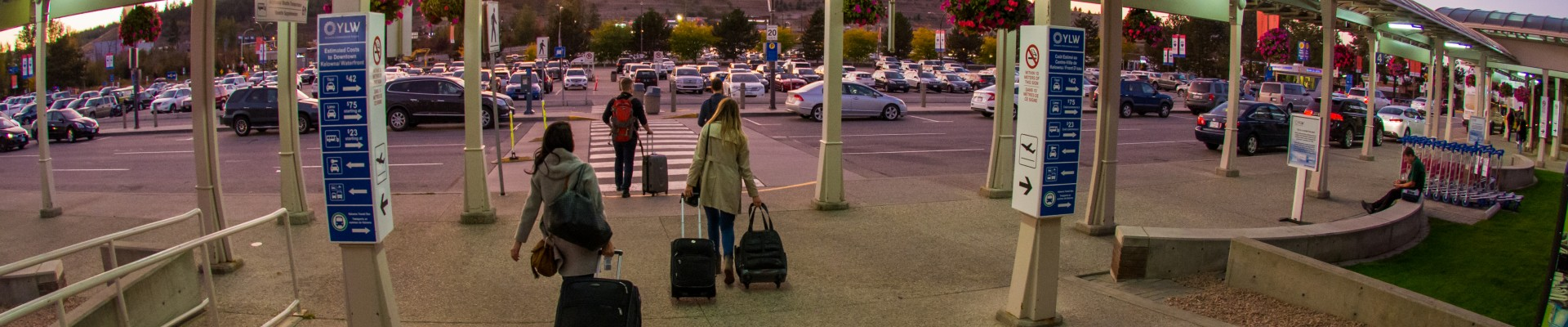 Passengers leaving the terminal at sunset